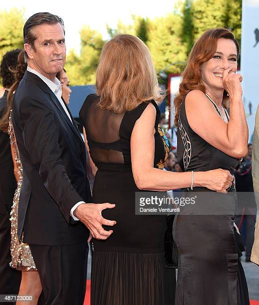 Rupert Everett squeezes Rosetta Sannelli as Monica Guerritore laughs as they attend the Kineo Awards ceremony during the 72nd Venice Film Festival at...