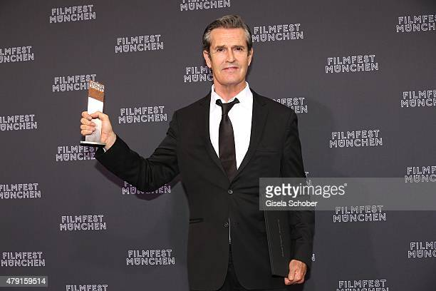 Rupert Everett with his award at the CineMerit Award Gala during the Munich Film Festival 2015 at Gasteig on July 1 2015 in Munich Germany