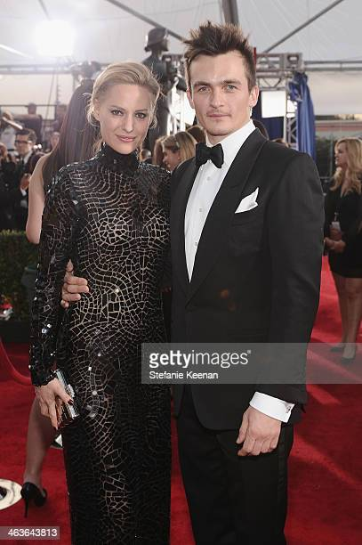 Rupert Friend and Aimee Mullins attend 20th Annual Screen Actors Guild Awards at The Shrine Auditorium on January 18 2014 in Los Angeles California