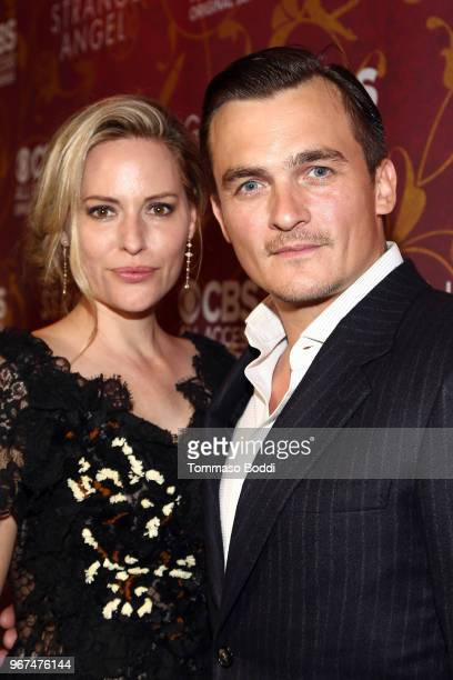 Rupert Friend and Aimee Mullins attend the Premiere Of CBS All Access' 'Strange Angel' at Avalon on June 4 2018 in Hollywood California