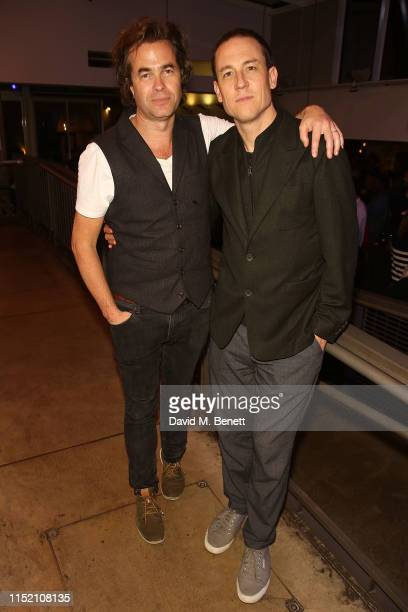 Rupert Goold and Tobias Menzies attend the press night after party for The Hunt at The Almeida Theatre on June 26 2019 in London England