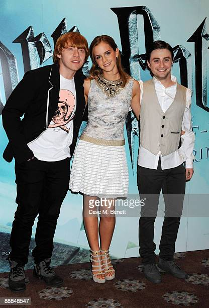 Rupert Grint Emma Watson and Daniel Radcliffe pose during the photocall of 'Harry Potter and the HalfBlood Prince' at Claridge's Hotel on July 6 2009...