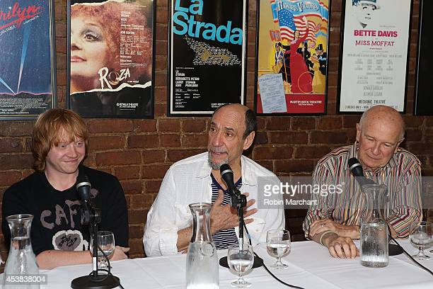 """Rupert Grint, F. Murray Abraham and Terrence McNally attend the """"It's Only A Play"""" Cast Photocall at Joe Allen Restaurant on August 19, 2014 in New..."""