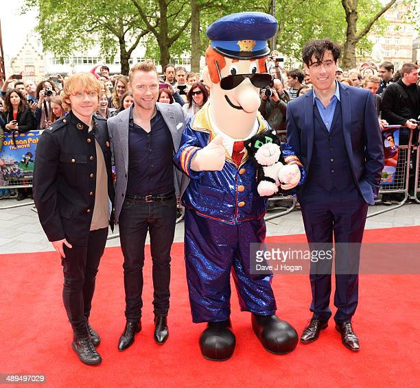 Rupert Grint Ronan Keating and Stephen Mangan attend the UK premiere of 'Postman Pat' at the Odeon West End on May 11 2014 in London England