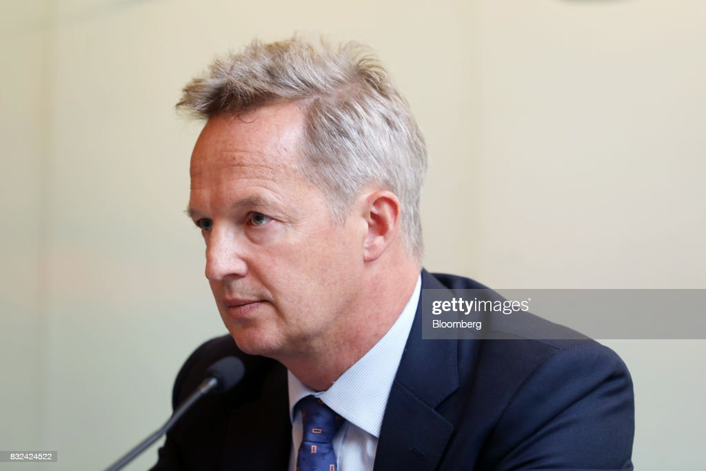 Rupert Hogg, chief executive officer of Cathay Pacific Airways Ltd., listens during a news conference in Hong Kong, China, on Wednesday, Aug. 16, 2017. Cathay Pacific is slipping in its efforts to get passengers to pay more for its premium services in a test for new Chief Executive Officer Hogg as the company reported back-to-back losses. Photographer: Paul Yeung/Bloomberg via Getty Images