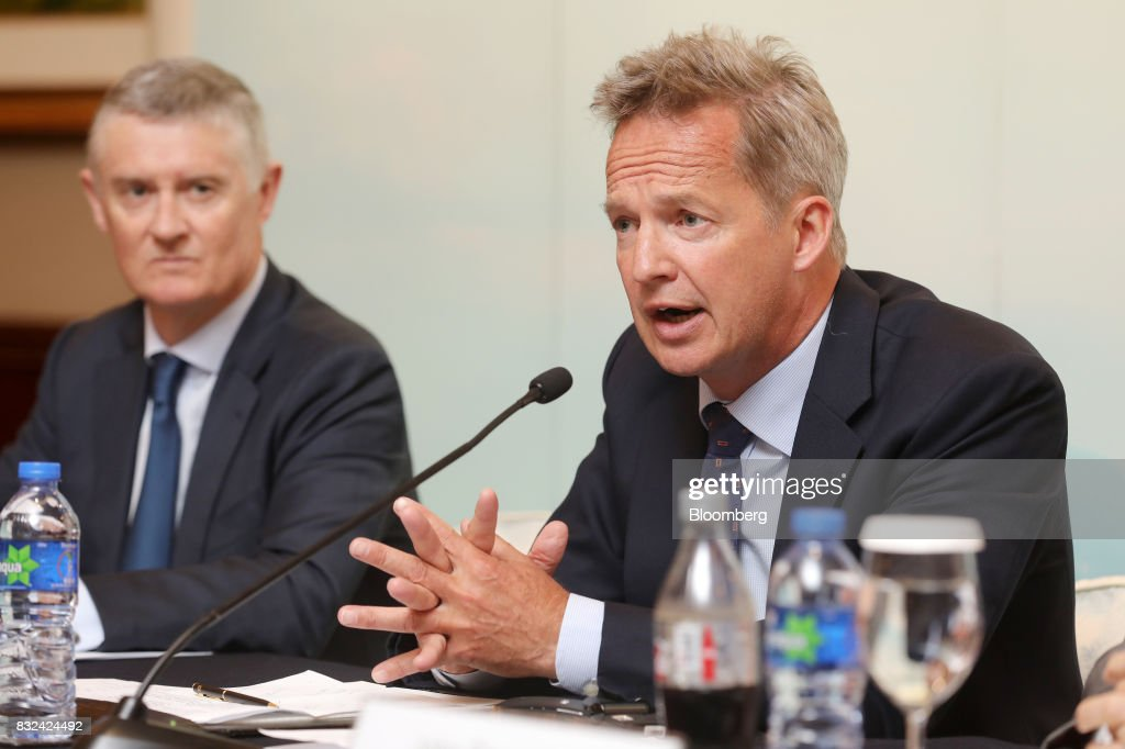 Rupert Hogg, chief executive officer of Cathay Pacific Airways Ltd., right, speaks during a news conference in Hong Kong, China, on Wednesday, Aug. 16, 2017. Cathay Pacific is slipping in its efforts to get passengers to pay more for its premium services in a test for new Chief Executive Officer Hogg as the company reported back-to-back losses. Photographer: Paul Yeung/Bloomberg via Getty Images