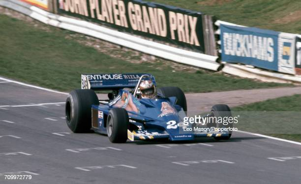 Rupert Keegan of Great Britain enroute to an eighth place finish, driving a Hesketh 308E with a Ford V8 engine for Penthouse Rizia Racing, during the...