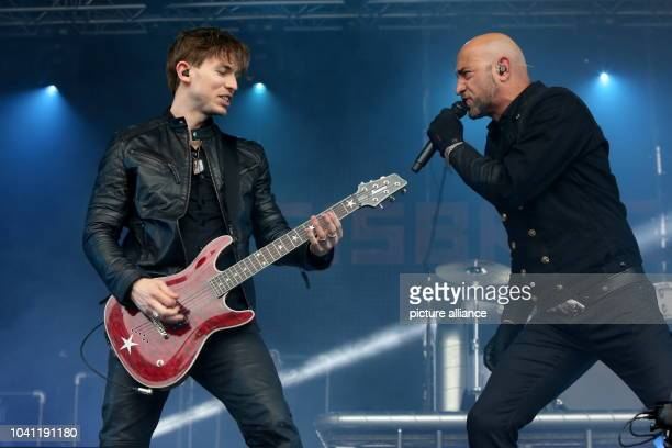 Rupert Keplinger on the electric guitar and frontman Alexander 'Alexx' Wesselsky perform with their rock band 'Eisbrecher' the Schlossgrabenfest...