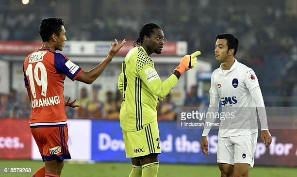 Rupert Lamlang of Delhi Dynamos FC and FC Pune City goalkeeper Apoula Edima and Gouramangi Singh in arguments during the India Super League football...