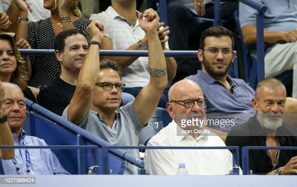 Rupert Murdoch and his son Lachlan Murdoch attend the quarter-final match of countryman John Millman of Australia against Djokovic on day 10 of the...