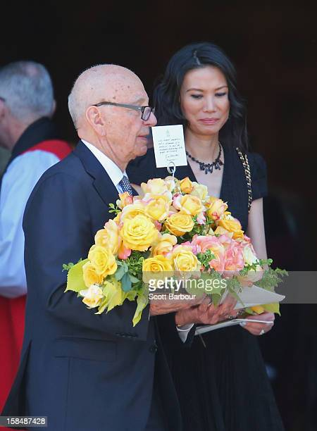 Rupert Murdoch carries flowers as he leaves with his wife Wendi Deng Murdoch after attending the Dame Elisabeth Murdoch public memorial at St Paul's...