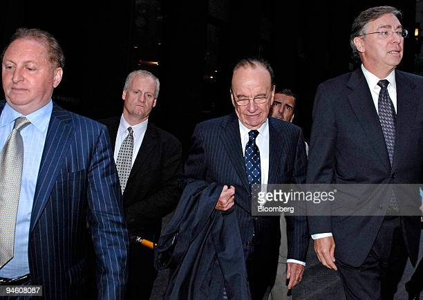 Rupert Murdoch center chairman and chief executive officer of News Corp leaves the offices of Wachtell Lipton Rosen Katz after meeting with the...