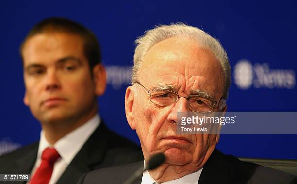 Rupert Murdoch CEO of News Corporation fields a question watched by his son Lachlan Murdoch chairman of News Limited after News Corporation's Annual...