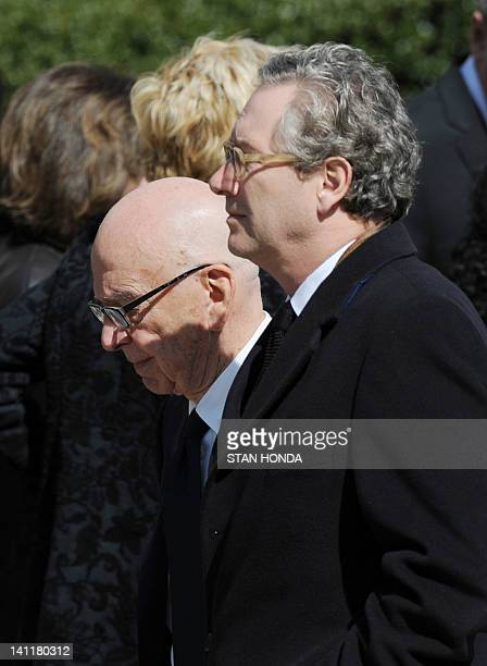 Rupert Murdoch Chairman and CEO of News Corp and John Witherow Editor of the Sunday Times of London leave the funeral of slain Times of London...