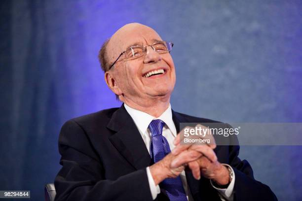 Rupert Murdoch chairman and chief executive officer of News Corp laughs during an interview at the National Press Club in Washington DC US on Tuesday...