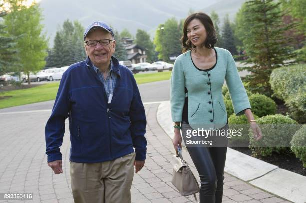 Rupert Murdoch chairman and chief executive officer of News Corp left and his wife Wendi Deng arrive for the morning session at the Allen Co Media...