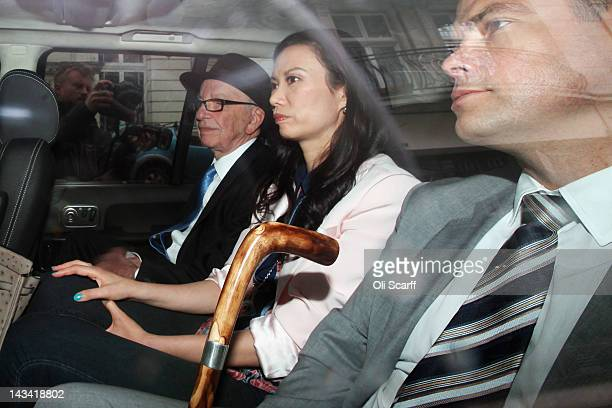 Rupert Murdoch is driven home from The Royal Courts of Justice with his wife Wendi Deng Murdoch and son Lachlan after giving evidence to The Leveson...