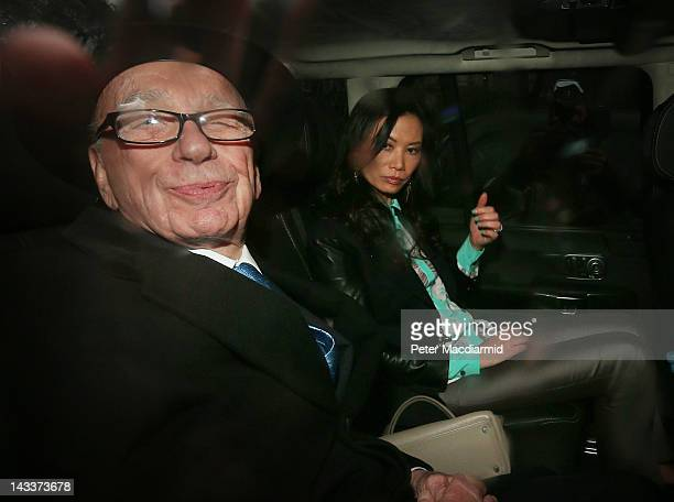 Rupert Murdoch leaves The Royal Courts of Justice with his wife Wendi Deng Murdoch after giving evidence to The leveson Inquiry on April 25 2012 in...