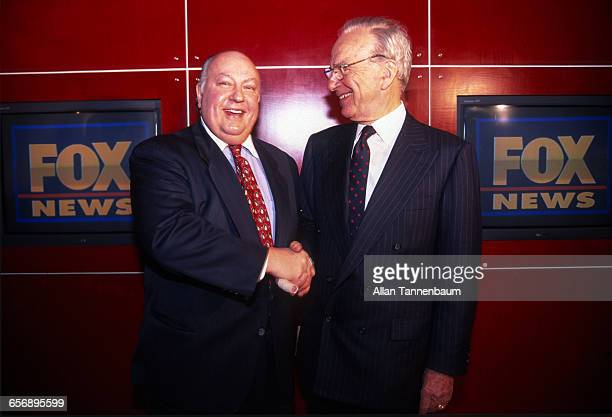 Rupert Murdoch shakes hands with Roger Ailes after naming Ailes the head of Fox News New York New York January 30 1996