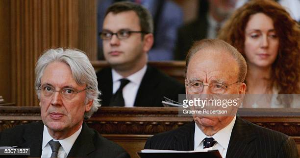 Rupert Murdoch sits alongside Les Hinton Andy Coulson News of The World editor and Rebekah Wade editor of The Sun in the service at St Brides Church...