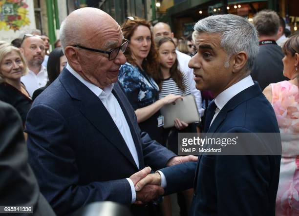 Rupert Murdoch speaks to London Mayor Sadiq Khan at Borough Market as it reopens to the public following the terrorist attack on June 14 2017 in...