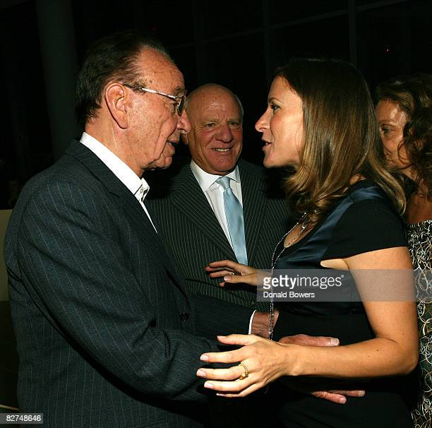 Rupert Murdock hugs Linda Avey as Barry Diller looks on during the 23 and Me Spit party at the IAC Building on September 9 2008 in New York City