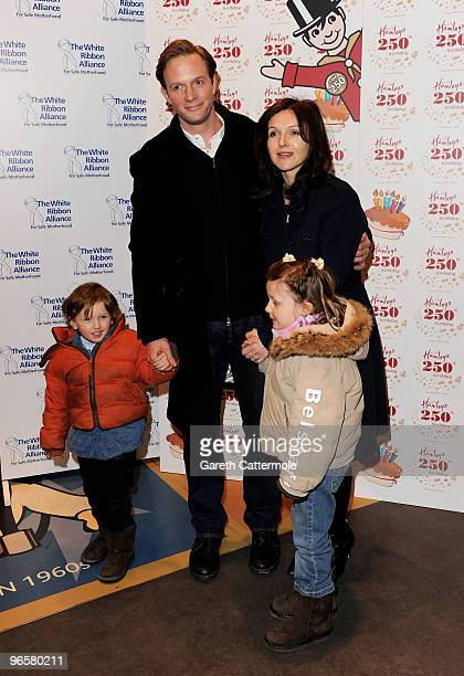 Rupert PenryJones and Dervla Kirwan with their children Peter and Florence attend the 250th Birthday Party of Hamleys at Hamleys on February 11 2010...