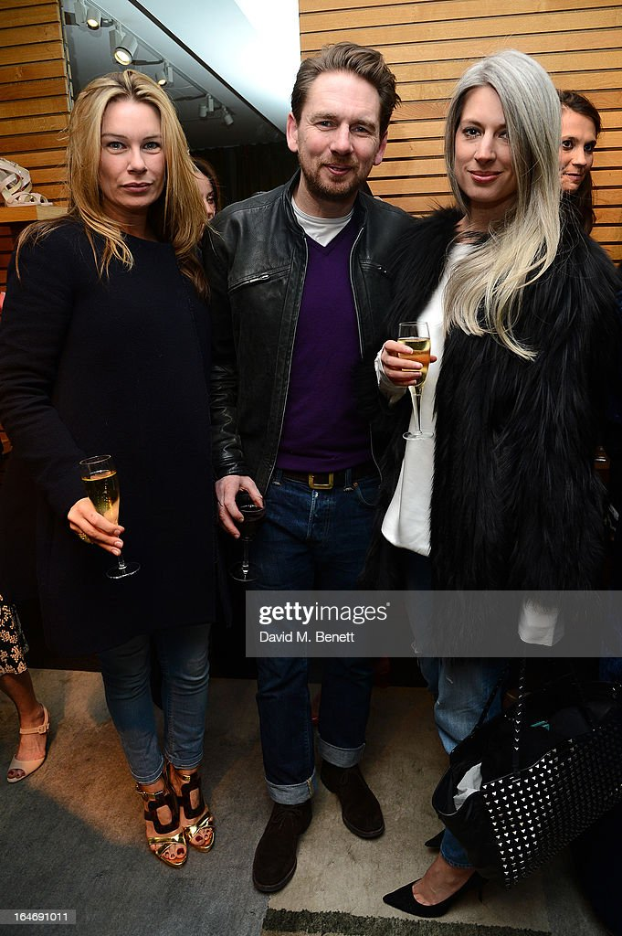 Rupert Sanderson, Sarah Harris and Pippa Vosper attend a cocktail party for shoe designer Rupert Sanderson, hosted by Mariella Frostrup, at his Bruton Place store on March 26, 2013 in London, England.