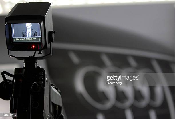 Rupert Stadler center chief executive officer of Audi AG is seen through a television monitor during a press conference in Ingolstadt Germany on...