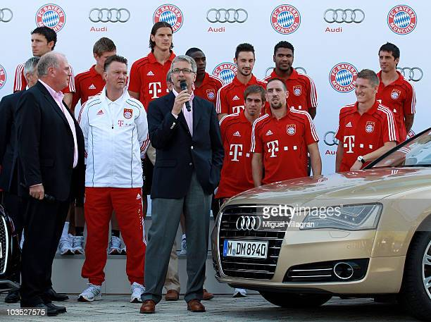 Rupert Stadler chief executive officer of Audi AG addresses the players head coach Louis van Gaal and Uli Hoeness president of FC Bayern Munich...