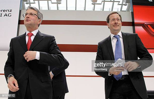 Rupert Stadler chief executive officer of Audi AG left and Axel Strotbek chief financial officer of Audi AG arrive for the company's full year...
