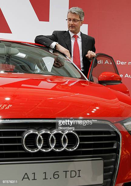 Rupert Stadler chief executive officer of Audi AG poses next to an Audi A1 automobile during the company's full year earnings press conference in...