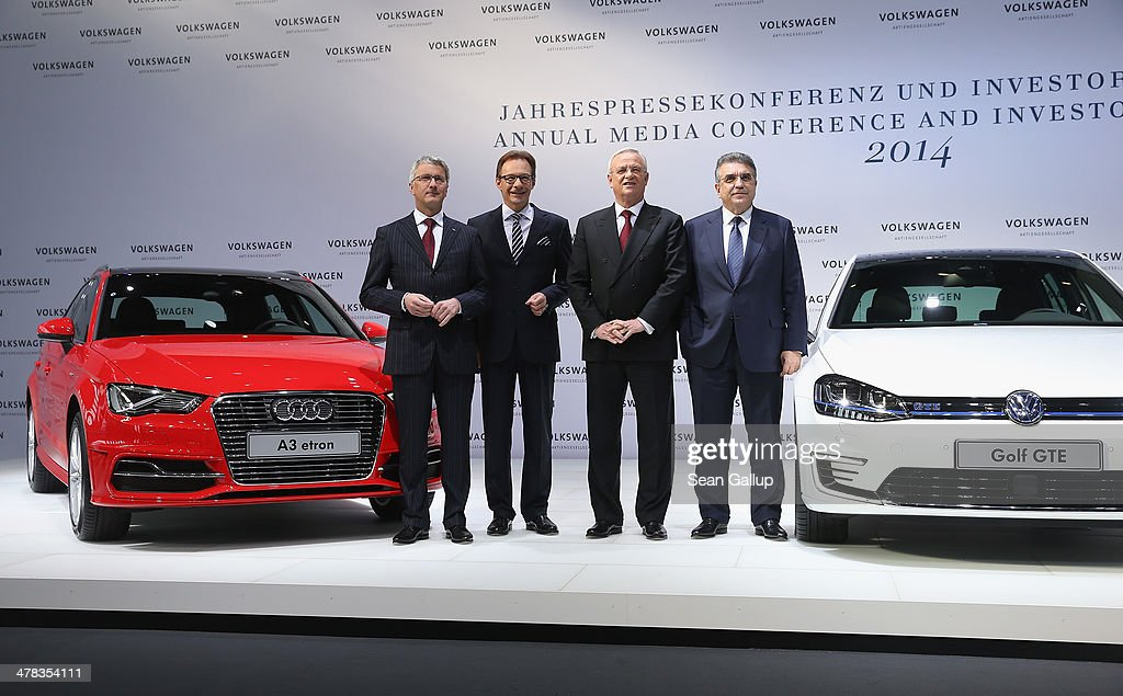 , Rupert Stadler, head of Audi AG, Michael Macht, head of Production at Volkswagen, Martin Winterkorn, Chairman of German carmaker Volkswagen AG, and Francisco Garcia Sanz, head of Procurement at VW, pose for the media prior to the company's annual press conference to announce financial results for 2013 on March 13, 2014 in Berlin, Germany. Volkswagen Group delivered over nine million vehicles worldwide in 2013.