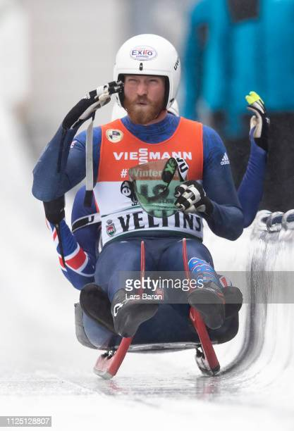 Rupert Staudinger and John Paul Kibble of Great Britain react after the final run of the Luge World Championship double race at Veltins Eis-Arena on...