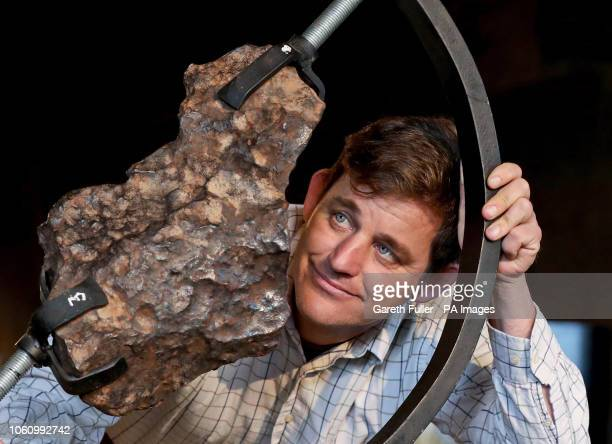 Rupert van der Werff of Summers Place Auctions in Billingshurst Sussex with a Gibeon meteorite piece from the Namibian desert which weighs 63kg and...