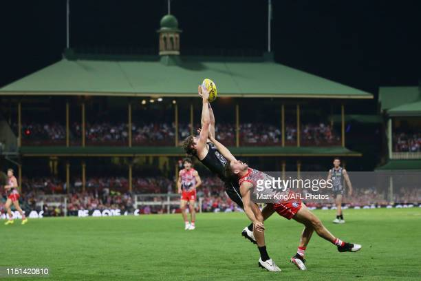 Rupert Wills of the Magpies competes for the ball against Jake Lloyd of the Swans during the round 10 AFL match between the Sydney Swans and the...