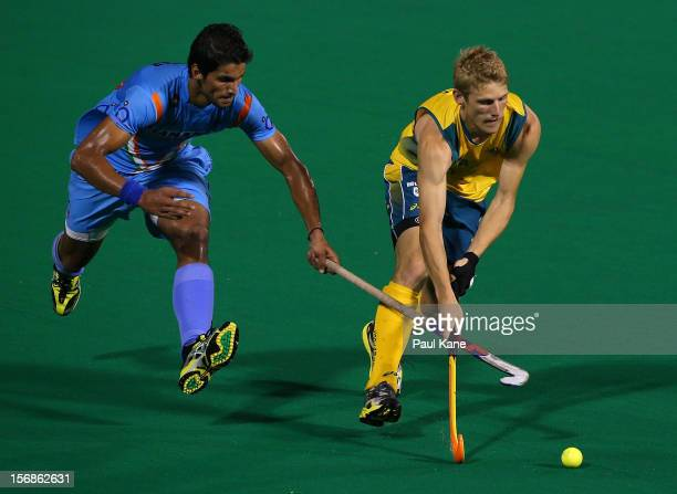 Rupinder Pal Singh of India and Craig Boyne of the Kookaburras contest for the ball in the mens Australia Kookaburras v India game during day two of...