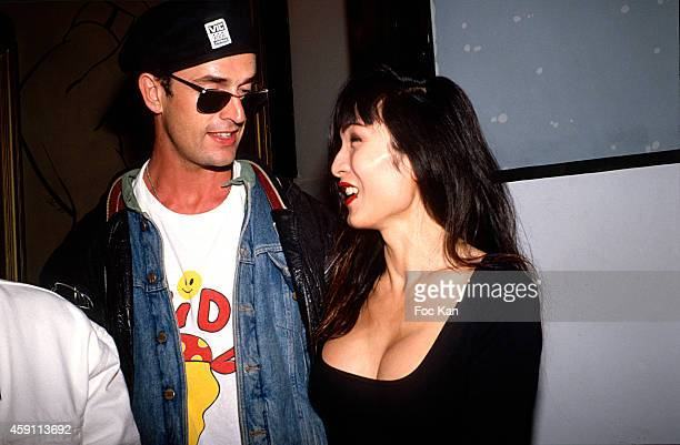 Ruppert Everett and Litchy attend a fashion week Party at Les Bains Douches in the 1990s in Paris France