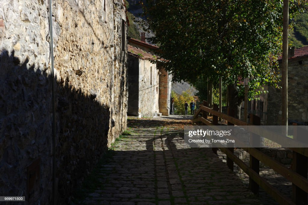 Rural atmoshere in Bulnes - El Castillo with a few stone houses : Stock Photo