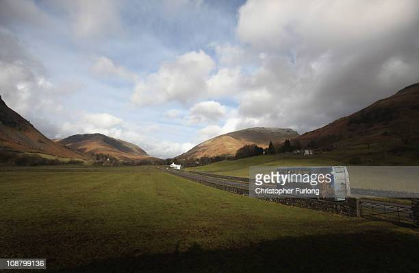 A rural bus service makes it's way through the Lake District on February 3 2011 in Grasmere England More than two thirds of English councils are...