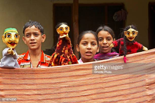 Rural children doing glove puppet show to highlight heath issues socio-economic initiative by NGO Chinmaya Organization