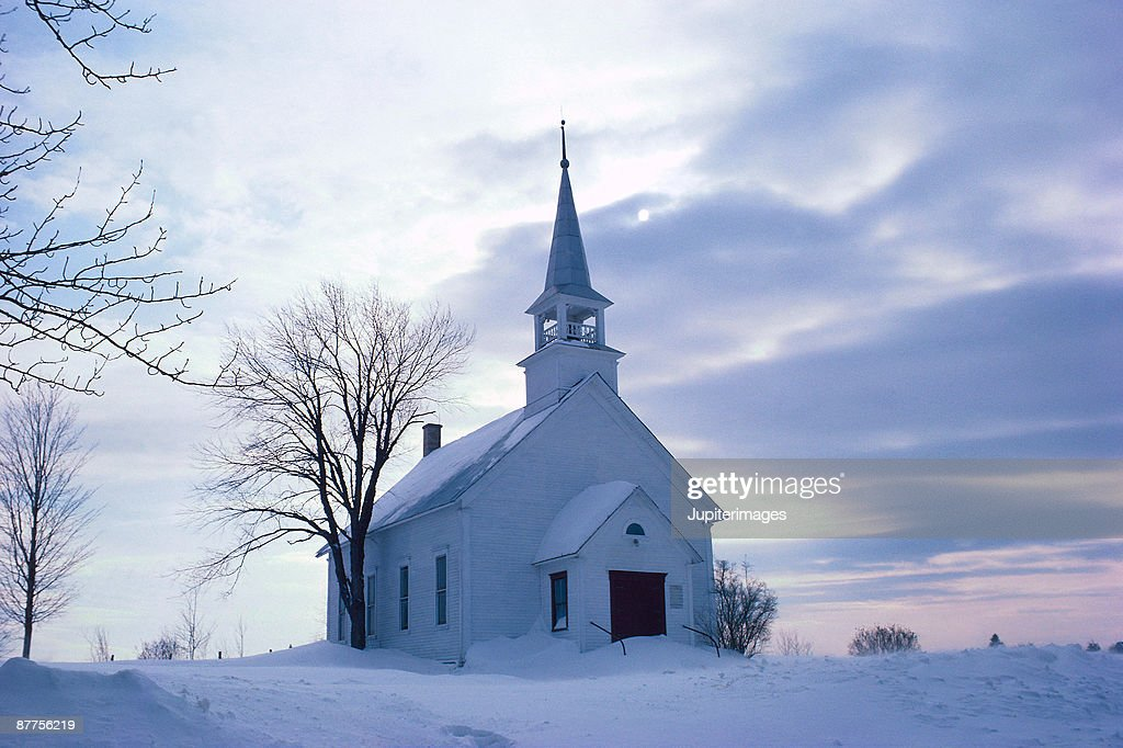 Rural church in winter landscape : ストックフォト