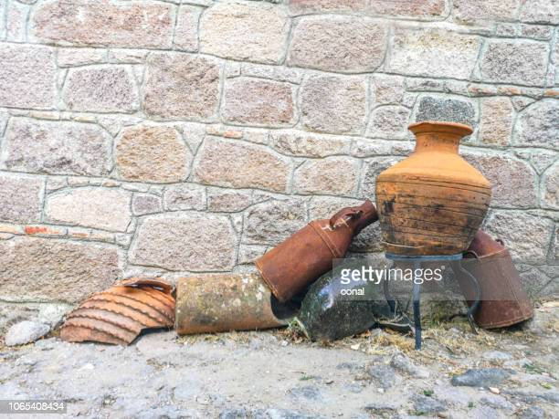 rural countryside wall surface with ancient amphoras - classic greek pottery stock photos and pictures