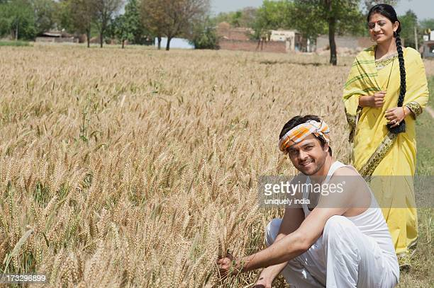 Rural couple in the field, Sohna, Haryana, India