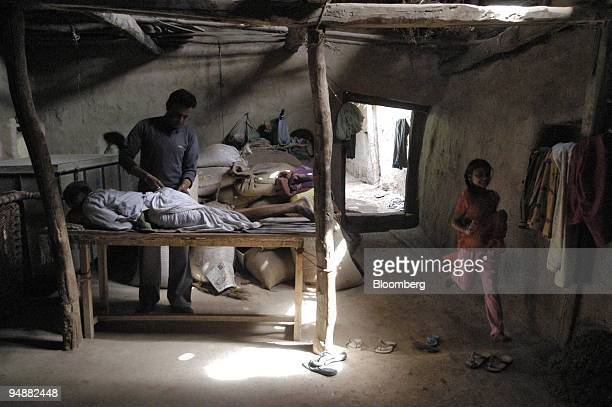 A rural doctor prepares to administer an injection to a patient in a small space in his house he has turned into a clinic in the village of Rajgarh...