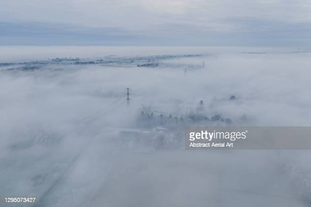 rural english countryside covered in freezing fog seen from above, england, united kingdom - village stock pictures, royalty-free photos & images