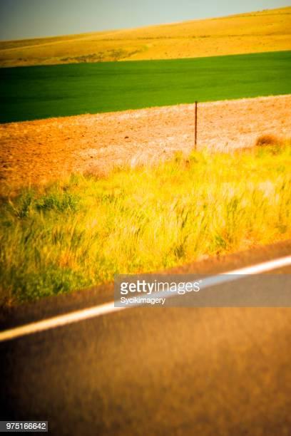 Rural field and hillside along highway