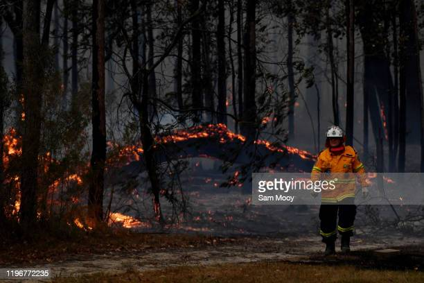 Rural Fire Service firefighters conduct property protection near the town of Sussex Inlet on December 31 2019 in Sydney Australia There are a number...
