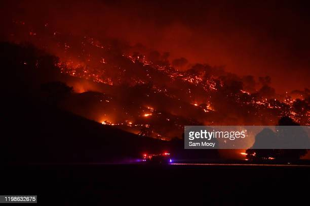 Rural FIre Service firefighters conduct property protection patrols at the Dunn Road fire on January 10, 2020 in Mount Adrah, Australia. NSW is...
