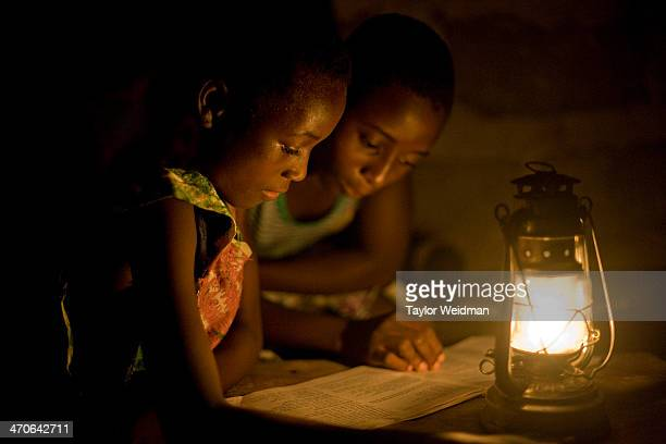Rural Ghanian students study with the help of a kerosene lantern in the evening Many villages in rural Ghana lack electrical infrastructure making it...